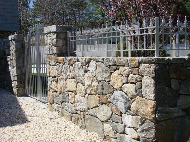 fieldstone-wall-with-metal-fence